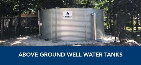 Above ground water well storage tanks